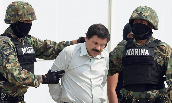 Mexican drug trafficker Joaquin Guzman Loera (el Chapo Guzman), is escorted by Marines as he is presented to the press in Mexico City on Feb. 22, 2014. (Alfredo Estrella/AFP/Getty Images)