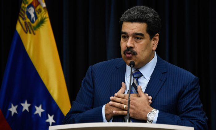 Venezuela's President Nicolas Maduro speaks during a press conference at the Miraflores presidential palace in Caracas, on Dec. 12, 2018. The Lima Group is rejecting the legitimacy of Maduro's new term and imposing political and economic sanctions against his regime. (Federico Parra/AFP/Getty Images)