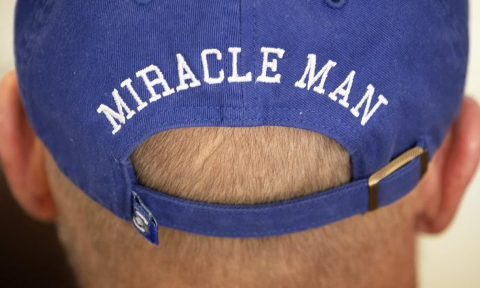 In this Thursday, Jan. 3, 2019 photo, T. Scott Marr wears a miracle man hat during a press conference in Omaha, Neb. Thought to be brain dead, Marr awakened after being taken off life support. (Kent Sievers/Omaha World-Herald/AP)