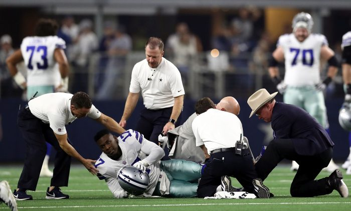 Allen Hurns #17 of the Dallas Cowboys is attended to after being injured in the first quarter during the Wild Card Round against the Seattle Seahawks at AT&T Stadium in Arlington, Texas, on Jan. 5, 2019. (Ronald Martinez/Getty Images)