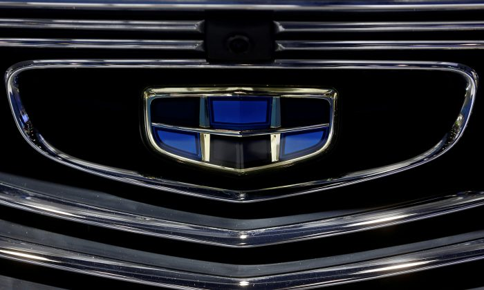 The emblem of the Geely automobile maker logo is seen at the IEEV New Energy Vehicles Exhibition in Beijing on Oct. 18, 2018.  (Thomas Peter/Reuters)