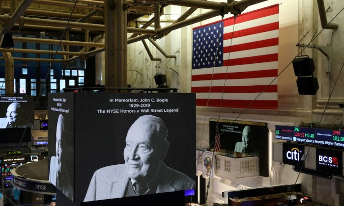 Screens display a tribute to Jack Bogle, founder and retired CEO of The Vanguard Group, on the floor of the New York Stock Exchange (NYSE) in New York, on Jan. 17, 2019. (Reuters/Brendan McDermid)