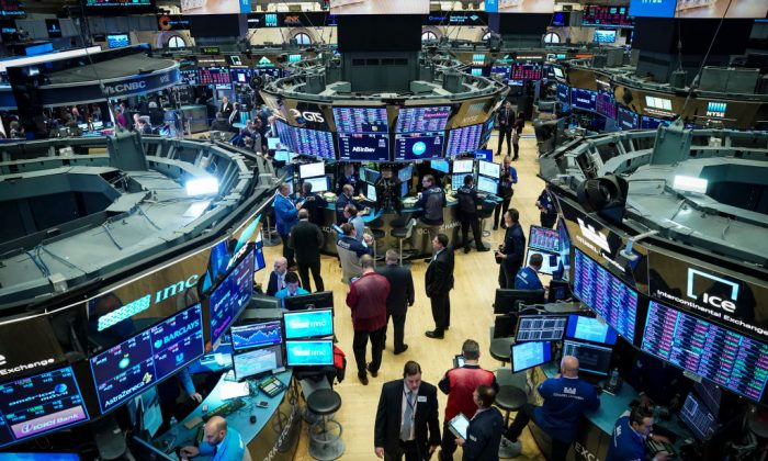 Traders and financial professionals work at the opening bell on the floor of the New York Stock Exchange (NYSE) in New York City, U.S. on Jan. 2, 2019. (Drew Angerer/Getty Images)