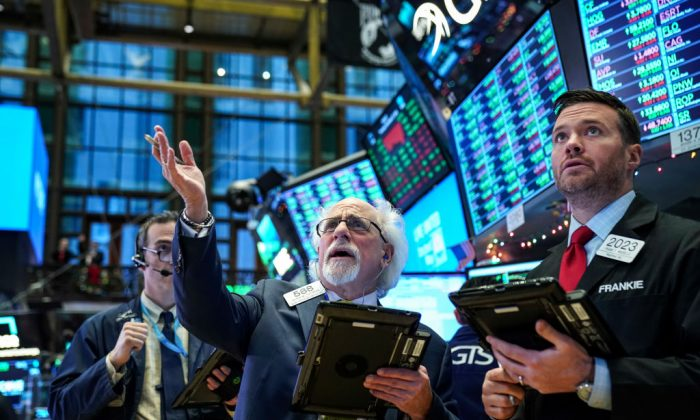 Traders and financial professionals work ahead of the closing bell on the floor of the New York Stock Exchange (NYSE), December 27, 2018 in New York City. After falling over 600 points earlier in the trading session, the Dow Jones Industrial Average ended the day up 260 points. (Drew Angerer/Getty Images)