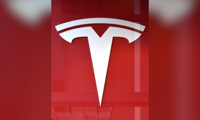 This photo shows the logo if US car maker Tesla in Brussels on February 8, 2018 - A day after launching one of its cars into space, Tesla moved on February 7 to ease concerns on earth over production delays for its Model 3, the key to future growth for the star electric carmaker. (Emmanuel DUNAND/AFP/Getty Images)