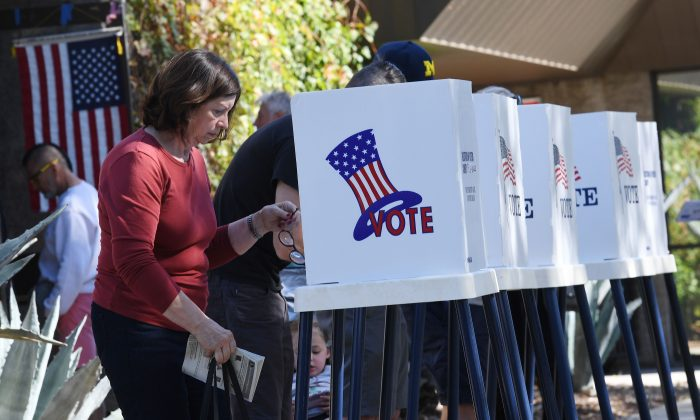 People vote at outdoor booths during early voting for the mid-term elections in Pasadena, California on Nov. 3, 2018. (MARK RALSTON/AFP/Getty Images)
