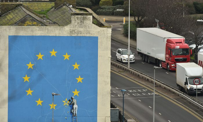 A mural by Banksy depicting a workman chipping away at one of the stars on a European Union themed flag, in Dover, south east England on Jan. 7, 2019. (Glyn Kirk/AFP/Getty Images)