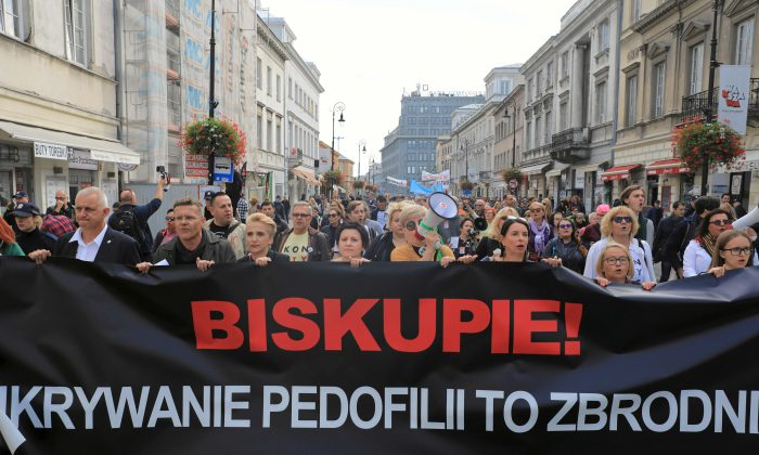 People take part during a demonstration against pedophilia in Warsaw on Oct. 7, 2018. The banner reads 'Bishop, hiding pedophilia is a crime.' (Agencja Gazeta/Jacek Marczewski via Reuters)