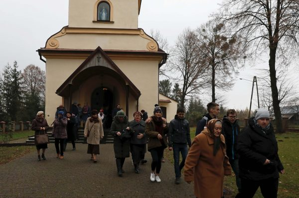 Parishioners leave the church after the mass in Kalinowka, Poland