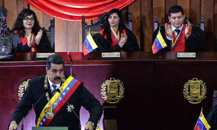 Justice Christian Zerpa (top-R) applauds as Venezuelan President Nicolas Maduro speaks during the opening of the judicial year at the Supreme Court in Caracas, on Feb. 14, 2018. (Federico Parra/AFP/Getty Images)