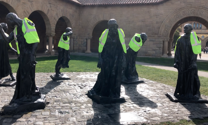 The group of statues called the Burghers of Calais, wearing yellow vests, on the campus of Stanford University in Palo Alto, Calif. on Jan. 7, 2018. (anonymous)