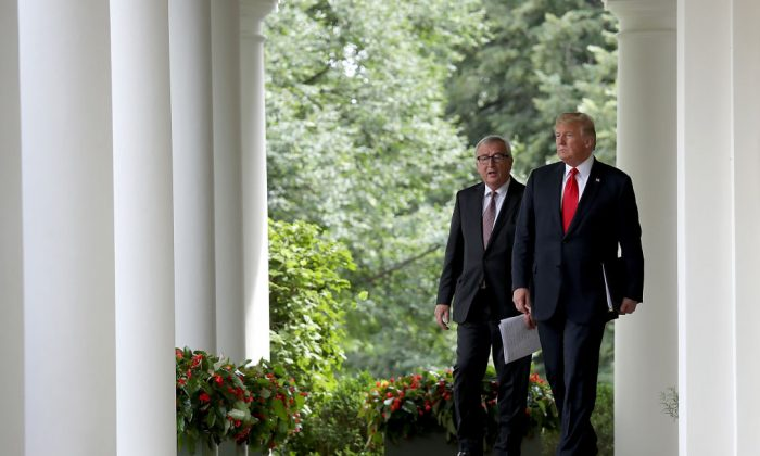President Donald Trump and European Commission President Jean-Claude Juncker walk to the Rose Garden of the White House to deliver a joint statement on trade in Washington, on July 25, 2018. (Win McNamee/Getty Images)