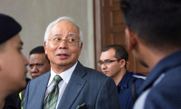 Malaysia's former Prime Minister Najib Razak exits the Kuala Lumpur High Court on Aug. 8, 2018 in Kuala Lumpur, Malaysia. (Ore Huiying/Getty Images)