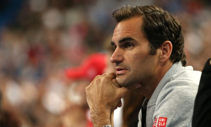 Roger Federer of Switzerland watches the women's singles match between Belinda Bencic of Switzerland and Maria Sakkari of Greece during day six of the 2019 Hopman Cup at RAC Arena in Perth, Australia, on Jan. 3, 2019. (Paul Kane/Getty Images)