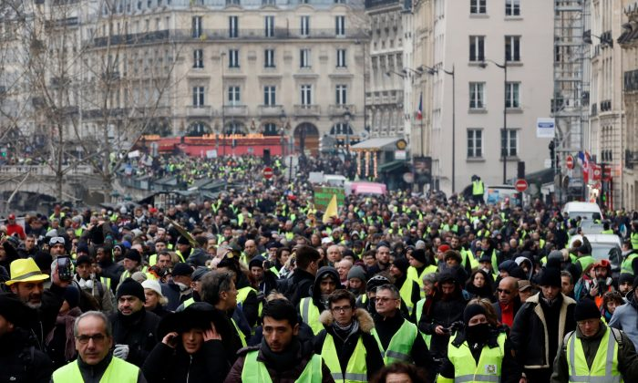 "Protesters wearing yellow vests take part in a demonstration by the ""yellow vests"" movement in Paris, France, January 5, 2019.  REUTERS/Gonzalo Fuentes"