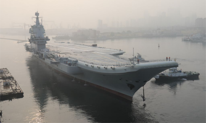 China's first domestically manufactured aircraft carrier, known only as 'Type 001A', leaves port in the northeast city of Dalian early on May 13, 2018. (-/AFP/Getty Images)