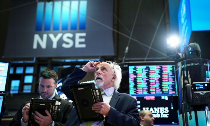 Traders and financial professionals work ahead of the closing bell on the floor of the New York Stock Exchange (NYSE), Dec. 27, 2018 in New York City. (Drew Angerer/Getty Images)
