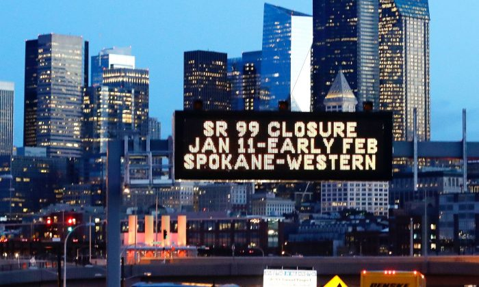 In this photo taken Friday, Jan. 4, 2019, a sign overhead advises of an upcoming closure of the the Alaskan Way Viaduct in Seattle. The double-decker highway along Seattle's waterfront is set to shut down for good Friday, Jan. 11, ushering in what officials say will be one of the most painful traffic periods in the city's history. (Elaine Thompson/AP)
