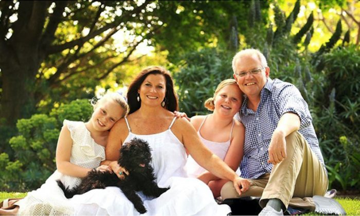 A handout photograph supplied by the Australian Department of Prime Minister and Cabinet shows a doctored version of a portrait of Australian Prime Minister Scott Morrison and his family that shows the political leader with two left shoes. (Department of Prime Minister and Cabinet/Handout/Reuters)