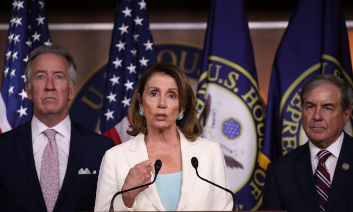 Rep. Richard Neal (D-MA) and Rep. John Yarmuth (D-KY), listen as Democratic Leader Nancy Pelosi (D-CA) speaks during her weekly press conference in the Capitol building on July 20, 2017 in Washington. (Joe Raedle/Getty Images)