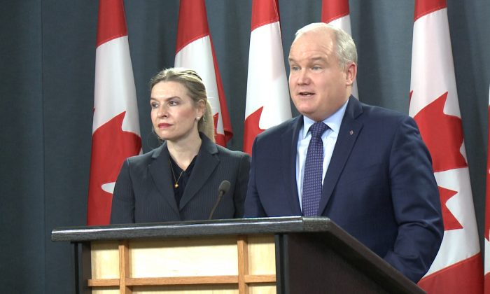 Conservative MPs Stephanie Kusie (L) and  Erin O'Toole speak at a press conference in Ottawa, Canada, on Jan. 8, 2018. (NTD Television)