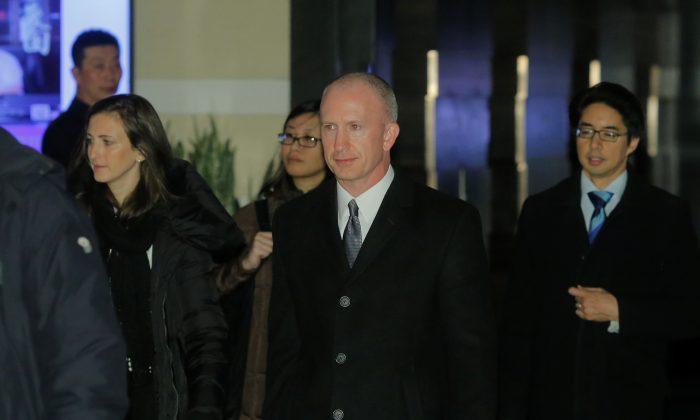 Deputy U.S. Trade Representative Jeffrey Gerrish, of the U.S. trade delegation to China, leaves a hotel in Beijing on Jan. 7, 2019. (Thomas Peter/Reuters)
