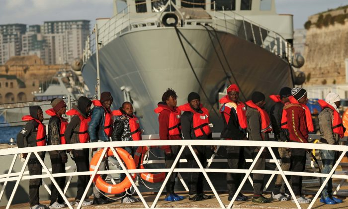 Migrants who were stranded on the NGO migrant rescue ships Sea-Watch 3 and Professor Albrecht Penck disembark from an Armed Forces of Malta patrol boat at its base in Marsamxett Harbour, Valletta, Malta, on Jan. 9, 2019. (Reuters/Darrin Zammit Lupi)