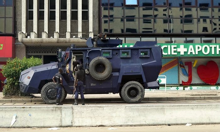 Congolese riot police takes position near the electoral commission building in Kinshasa, Congo, on Jan. 9, 2019. (Jerome Delay/AP Photo)