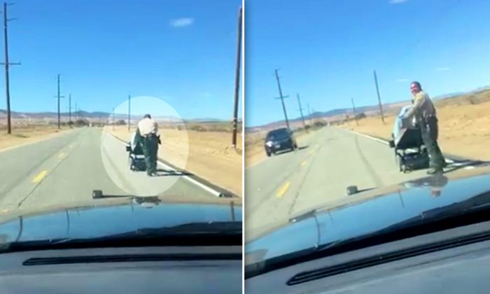 Two deputies, Chapman and Montanez, rescue elderly lady on wheelchair in the middle of a road in Lanceter, California. (Facebook Video Screenshot | Lancaster Sheriff's Station)