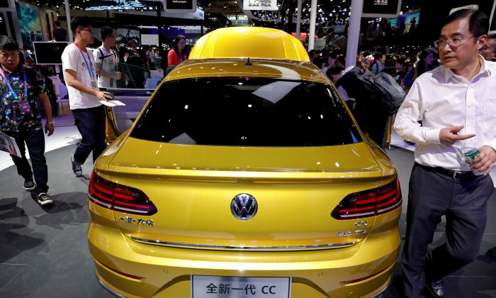 The new Volkswagen CC is displayed during a media preview of the Auto China 2018 motor show in Beijing on April 25, 2018. (Damir Sagolj/Reuters)