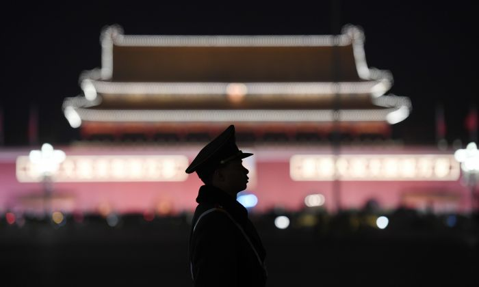 A paramilitary police officer stands guard in Tiananmen Square in Beijing on March 11, 2018. (Greg Baker/AFP/Getty Images)