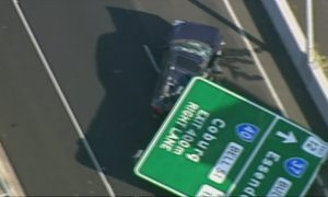 Overhead Road Sign Falls and Crushes Car in Freak Accident, Woman Injured