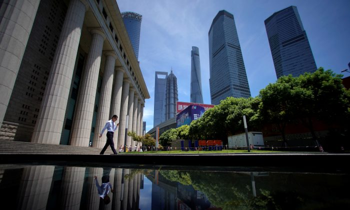 A man walks at Lujiazui financial district of Pudong in Shanghai on July 17, 2017. (Aly Song/Reuters)