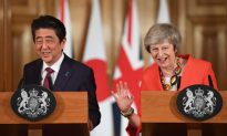 After Meeting UK's May, Japan's Abe Says World Does Not Want No-deal Brexit
