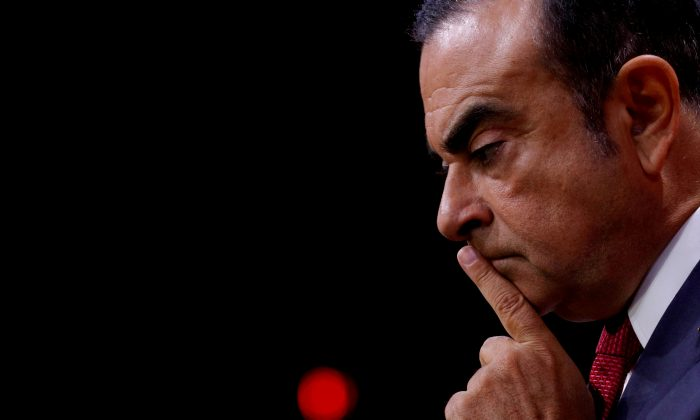 Carlos Ghosn, Chairman and CEO of the Renault-Nissan Alliance, reacts during a news conference in Paris, France, September 15, 2017. (Philippe Wojazer/Reuters)