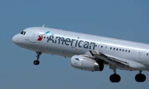 Woman Hits Man in the Head With Laptop on American Airlines Flight in Viral Video