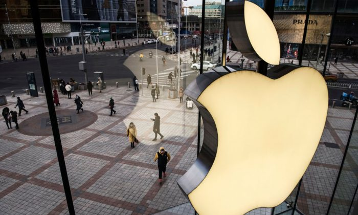 The Apple logo is seen on the window at an Apple Store on Jan. 7, 2019 in Beijing, China. (Kevin Frayer/Getty Images)