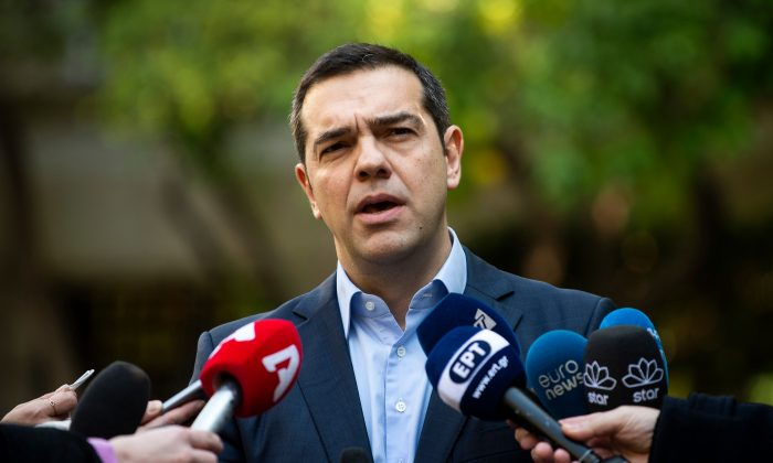 Greek Prime Minister Alexis Tsipras makes statement to the media after meeting with Greek Defense Minister and coalition partner Panos Kammenos in Athens on Jan. 13, 2019. (Angelos Tzortzinis/AFP/Getty Images)