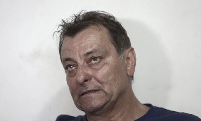 Italian leftist militant Cesare Battisti gestures during an interview with AFP in Cananeia, Sao Paulo state, Brazil, on Oct. 20, 2017.  (Miguel Schincariol/AFP/Getty Images)