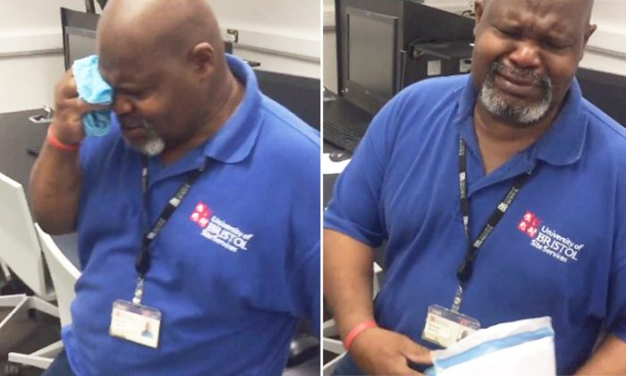Herman Gordon, a cleaner at Bristol University, bursts into tears as students give him an appreciation letter along with a white envelope.  (Facebook | Bristruths)