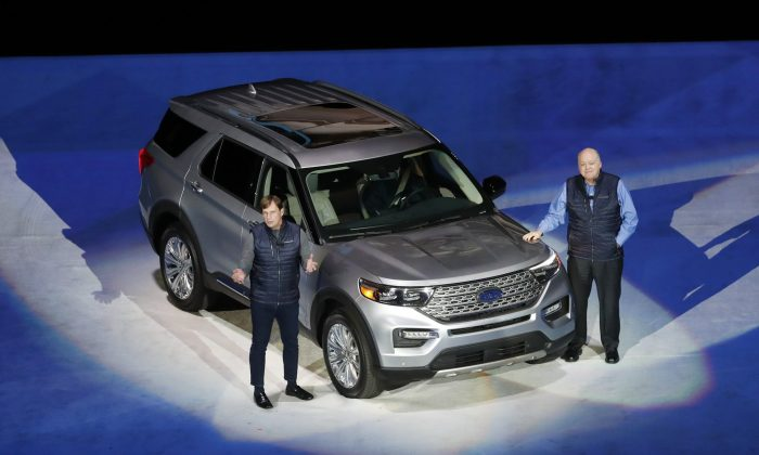 Ford Motor Co., President, Global Markets Jim Farley, left, and President and CEO Jim Hackett stand next to the redesigned 2020 Ford Explorer during its unveiling, in Detroit. (AP Photo/Carlos Osorio)
