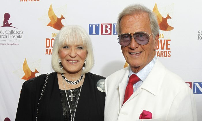 Pat Boone, right, and wife Shirley Boone arrive at Lipscomb University for the Dove Award, in Nashville, Tenn., on Oct. 7, 2014. (Wade Payne/Invision/AP)