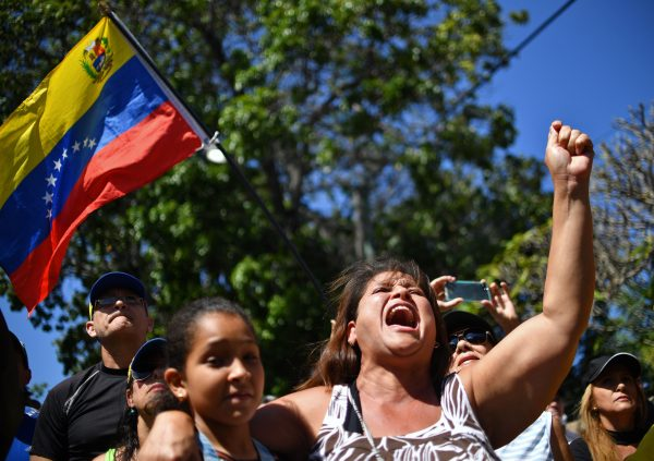 A woman shouts slogans as opposition supporters wait for the arrival of National Assembly President Juan Guaido for an open meeting in Vargas, Venezuela, on Jan. 13, 2019. (Yuri Cortez/AFP/Getty Images)