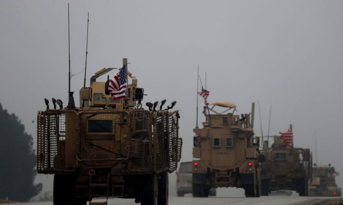 A picture taken on Dec. 30, 2018, shows a line of US military vehicles in Syria's northern city of Manbij. (DELIL SOULEIMAN/AFP/Getty Images)