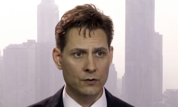 Michael Kovrig, an adviser with the International Crisis Group, a Brussels-based non-governmental organization, speaks during an interview in Hong Kong on March 28, 2018. (AP Photo/File)