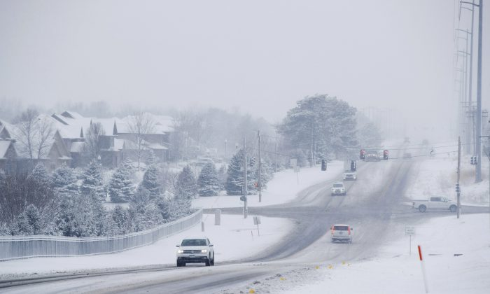 Cars during a snow storm in a file photo. (Ryan Soderlin/Omaha World-Herald via AP)