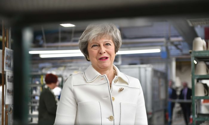 British Prime Minister Theresa May visits the Portmeirion factory in Stoke-on-Trent, United Kingdom, on Jan. 14, 2019. (Ben Birchall/Pool via Reuters)