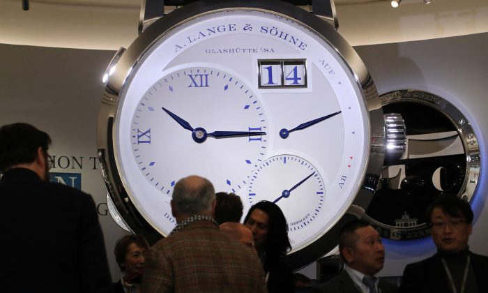 "Visitors are pictured on the A. Lange & Soehne stand, part of Richemont luxury group at the ""Salon International de la Haute Horlogerie"" (SIHH) watch fair in Geneva, Switzerland on Jan. 14, 2019. (Denis Balibouse/Reuters)"