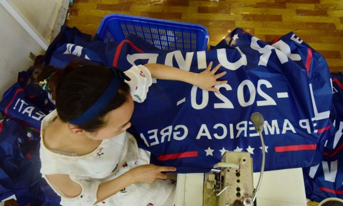 A woman sews a Trump 2020 flag in a file photo. (AFP/Getty Images)