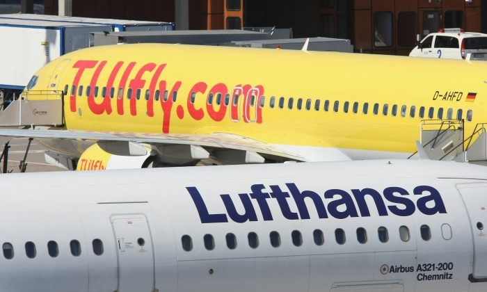Passenger planes of German airliners Lufthansa and TUI pass one another at Tegel Airport in Berlin, Germany, on July 29, 2008. (Sean Gallup/Getty Images)